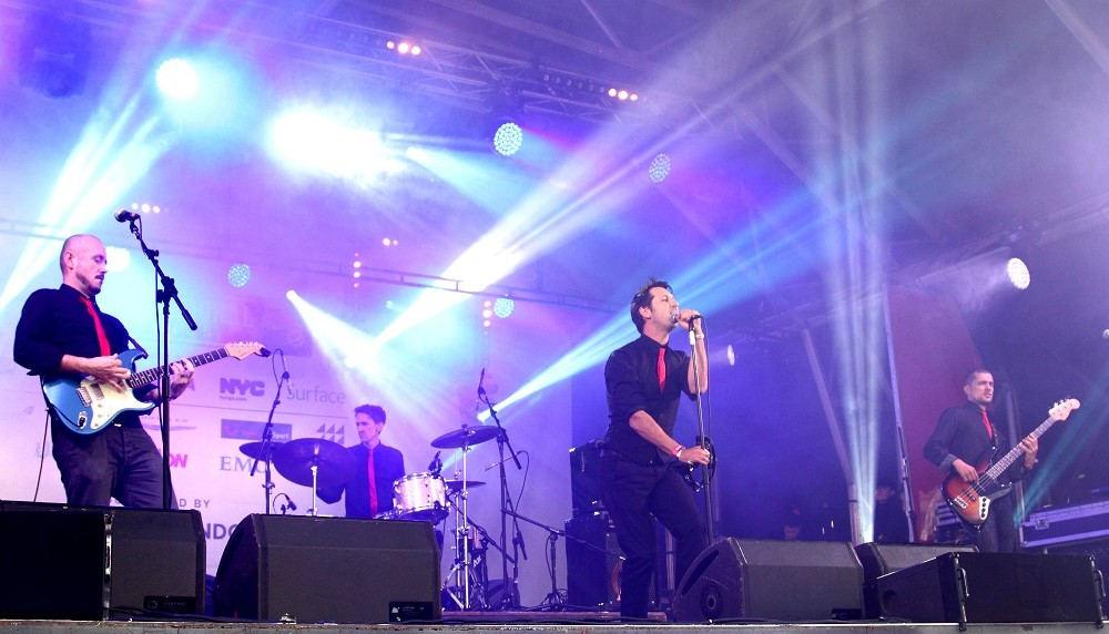 Meta Slider - HTML Overlay - 21st Century Riot perform at the NFL Fan Rally